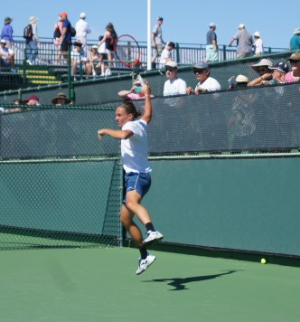 tennis player jumping